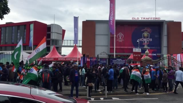 india and pakistan cricket fans arrive at old trafford for india v pakistan a bus outside the ground has a welcome message for pakistan players - cricket stock videos & royalty-free footage