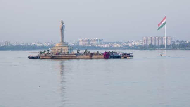 india, capital of telengana state, (andhra pradesh), hyderabad, buddha statue, hussain sagar lake - time lapse - lake stock videos & royalty-free footage