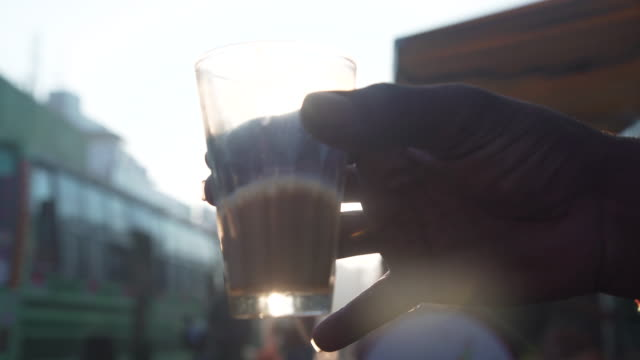 POV CU India chai masala tea glass hold by man