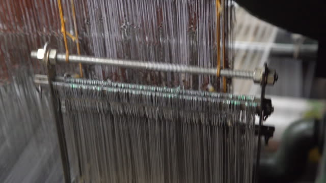india fabrics workshop. automatic knitting machines making sari, silk traditional clothing - newly industrialized country stock videos and b-roll footage