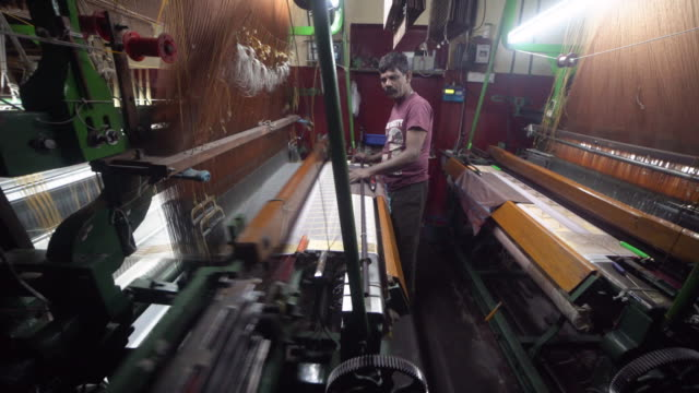 india fabrics workshop. automatic knitting machines making sari, silk traditional clothing - textile mill stock videos & royalty-free footage