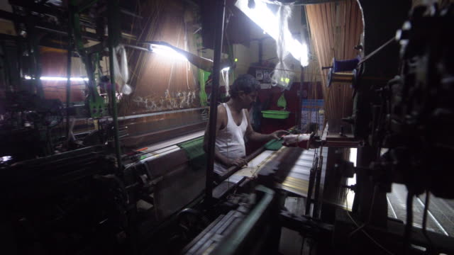 india fabrics workshop. automatic knitting machines producing sari - textile mill stock videos & royalty-free footage