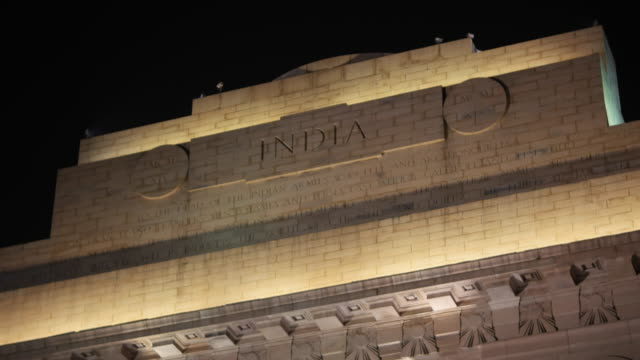 India Gate close-up of the architectural details, inscribtion, armed forces flags and the eternal flame