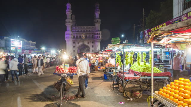 India, Hyderabad, capital of Telangana State, (Andhra Pradesh), Street stalls and the Charminar (Four Minarets) monument - time lapse