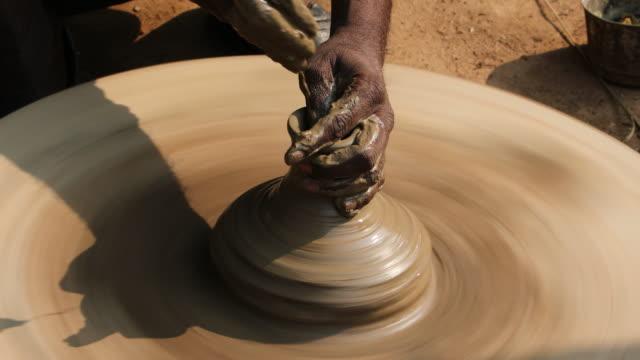 india, indian traditional work - pottery - 陶器点の映像素材/bロール