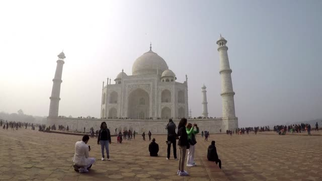 india is to restrict the number of daily visitors to the taj mahal in an attempt to preserve the iconic 17th century monument its biggest tourist... - taj mahal stock videos and b-roll footage