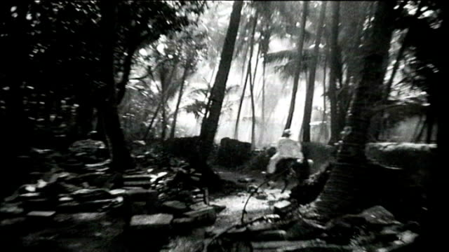 1925 india - men ride through forest - hooved animal stock videos & royalty-free footage