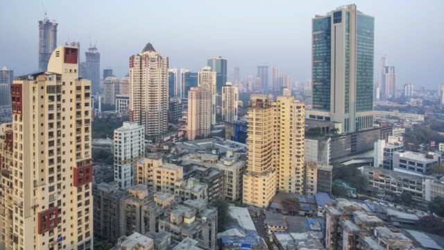 india, mumbai, maharashtra, city skyline time lapse of modern office and residential buildings - 集合住宅点の映像素材/bロール