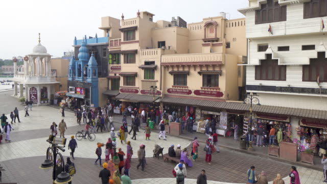 india, punjab, amritsar, heritage street, pedestrian only walking street to the golden temple - temple building video stock e b–roll