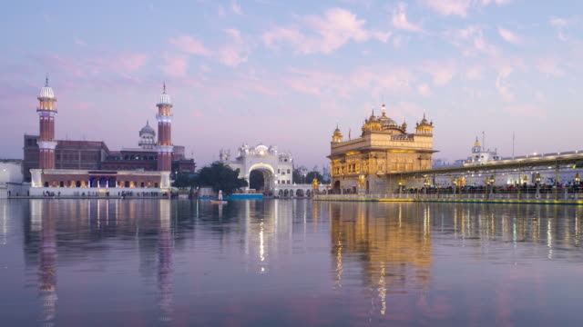 india, punjab, amritsar, (golden temple), the harmandir sahib, one of the most revered spiritual sites of sikhism - time lapse - temple building stock videos & royalty-free footage