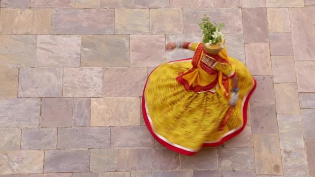 india, rajasthan, jaipur, samode, woman wearing colourful sari dancing - tradition stock videos & royalty-free footage