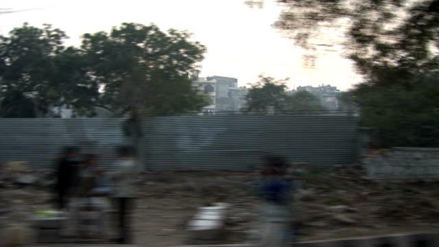 india side of a dust road, slum - slum stock videos & royalty-free footage