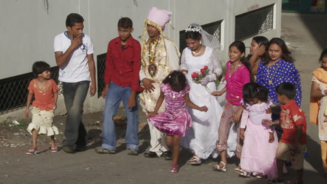 India wedding party walking through street