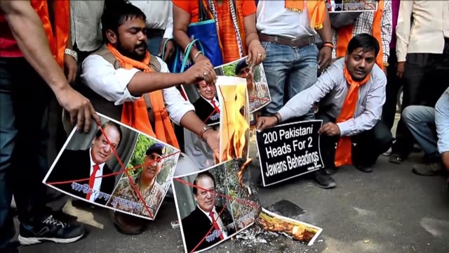 Indian activists from rightwing organisation hold protest against Pakistan's prime minister and army chief in Delhi after five policemen were shot...
