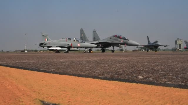 Indian Air Force Hawk fighter jet developed by BAE Systems Plc left and a Sukhoi fighter jet developed by Sukhoi Aviation Holding Co sit on the...