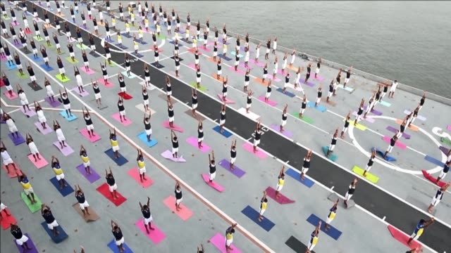 indian armed forces personnel take part in a yoga sesssion to mark international yoga day on the indian navy aircraft carrier ins viraat anchored at... - anchored stock videos & royalty-free footage