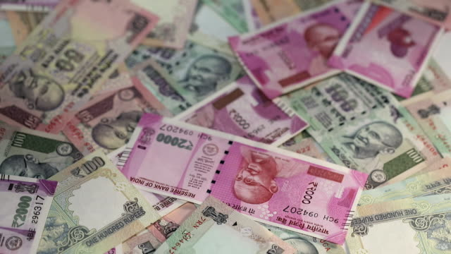 indian banknotes falling