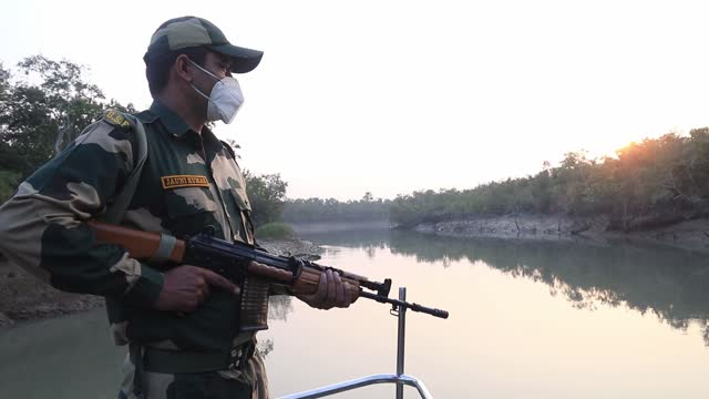 indian border security force soldiers patrol near the india-bangladesh international border area at sundarbans area, about 109 kilometers from... - international border stock videos & royalty-free footage