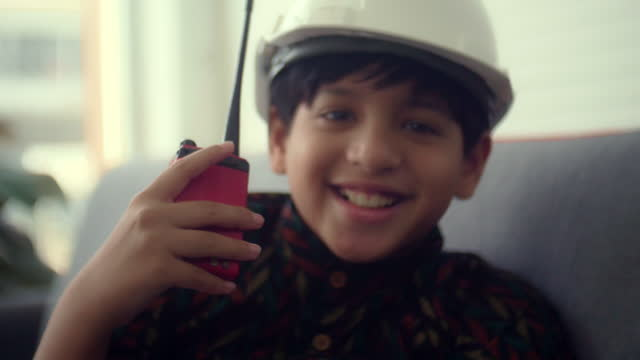 indian boy playing as an engineer - safety harness stock videos & royalty-free footage