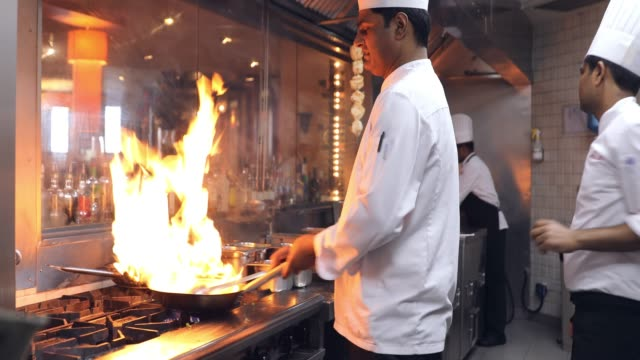 indian chefs cooking in a professional kitchen of a gourmet restaurant - flame stock videos & royalty-free footage