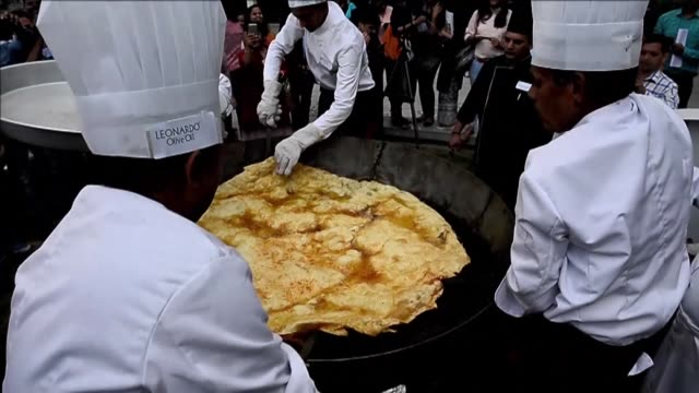 Indian chefs make a giant bhatura a deep fried bread in New Delhi with the end product measuring 147 cm in diameter in what organisers hope will be...