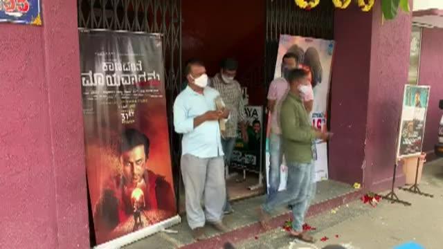 indian cinemas began reopening on thursday after a monthslong coronavirus shutdown despite india's virus cases surging past seven million - reopening stock videos & royalty-free footage