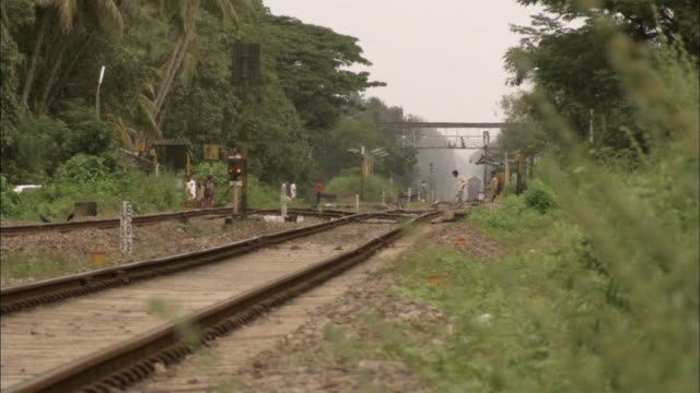 ms pov indian countryside / kerala, india - level crossing stock videos & royalty-free footage