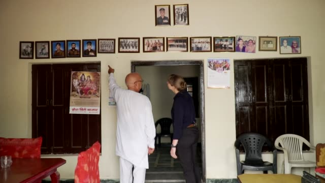 Exit polls suggest surprise win for Narendra Modi INDIA INT Ram Kumar at home chatting with reporter