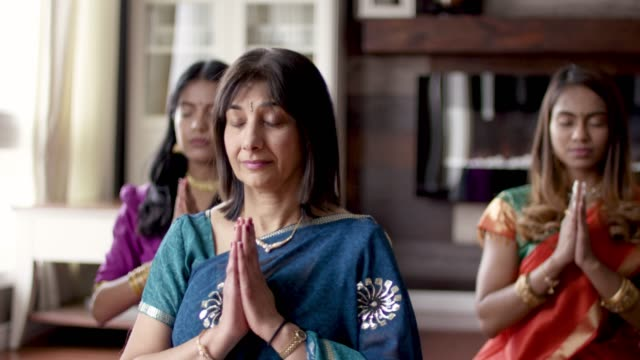 indian family praying together - indian subcontinent ethnicity stock videos & royalty-free footage