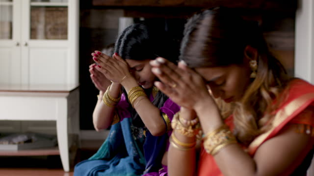indian family praying together - meditating stock videos & royalty-free footage