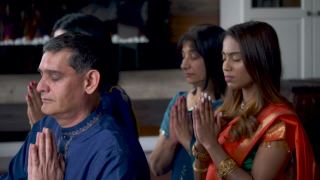 indian family praying together - respect stock videos & royalty-free footage