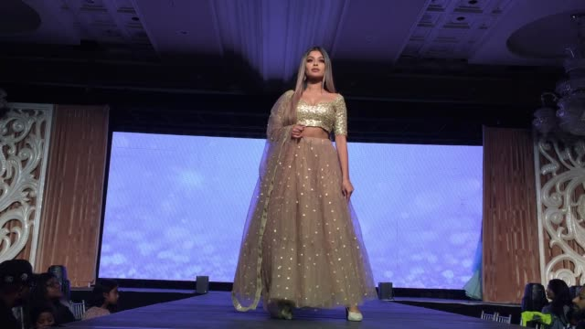 indian fashion models showcase elegant and ornate bridal lehengas during a south indian and sri lankan bridal fashion show in ontario, canada, on... - indian ethnicity点の映像素材/bロール