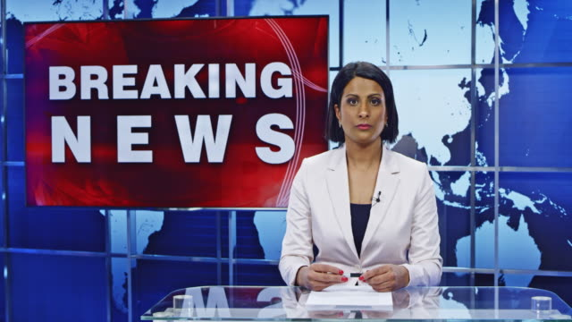 ld indian female anchor presenting breaking news on floods - breaking news stock videos and b-roll footage