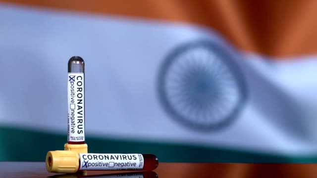 indian flag flapping behind the blood test tubes - india video stock e b–roll