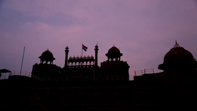 indian flag fluttering on a red fort  - indian flag stock videos & royalty-free footage