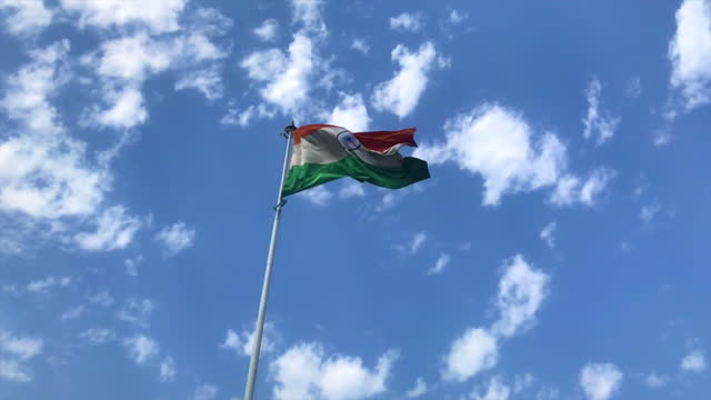 indian flag waving in the air under blue sky - 1947 stock videos & royalty-free footage