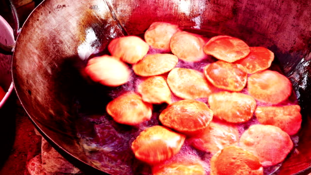 indian food pudi or puri being fried at home - sweet food stock videos & royalty-free footage