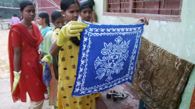 indian girl showing batik material - batik stock videos and b-roll footage