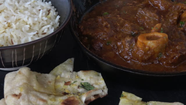 indian goat curry - cast iron stock videos & royalty-free footage