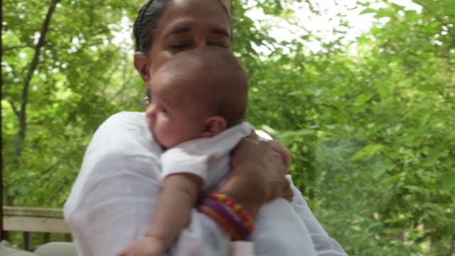 indian grandfather holding newborn. - 生後1ヶ月点の映像素材/bロール