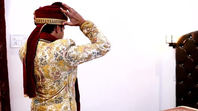 indian groom wearing wedding turban in slow motion - shawl stock videos & royalty-free footage