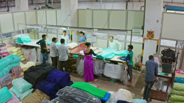 indian group of people working factory in the packaging area - textile industry stock videos & royalty-free footage