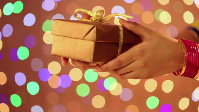 indian housewife giving gift - giving stock videos & royalty-free footage