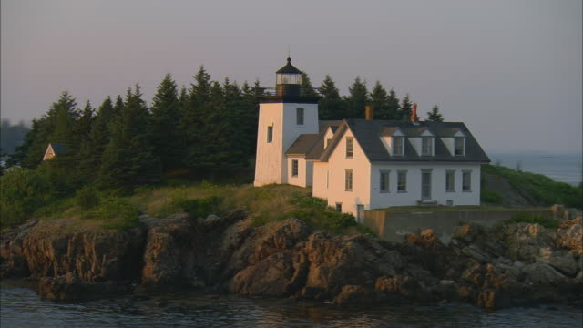 low aerial, indian island lighthouse at sunset, rockport, maine, usa - rockport maine stock videos & royalty-free footage