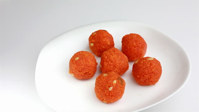 indian laddoo a very popular sweet dish in india - snack stock videos and b-roll footage