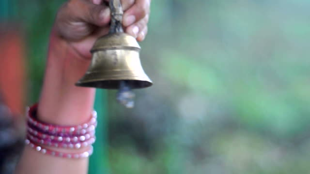 Indian lady is ringing bell