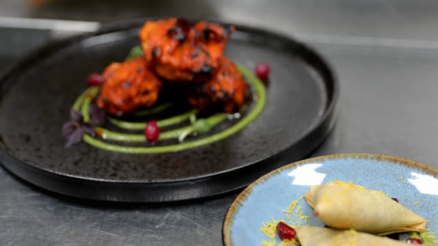indian main course ready to serve in a gourmet restaurant - indian food stock videos & royalty-free footage