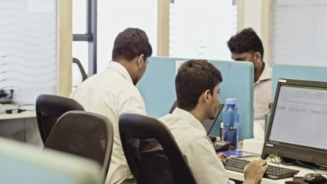indian male professionals working at creative office - indian ethnicity stock videos & royalty-free footage