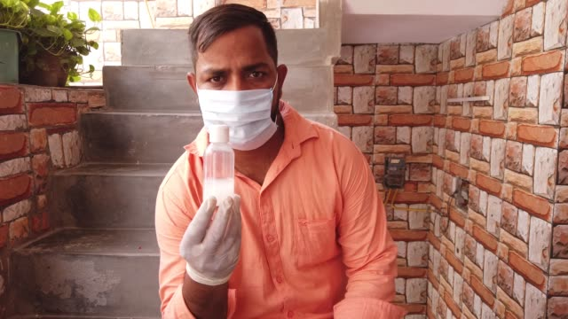 indian man at home cleaning, disinfecting and washing hands rigorously in line with following the global who protocols, rules and regulations - washing up glove stock videos & royalty-free footage