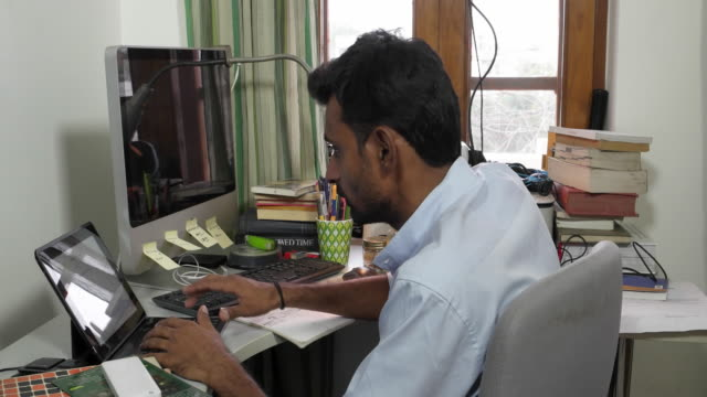 Indian man busy on a work table at home